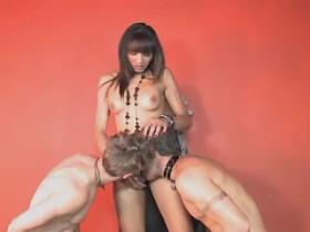 Beautiful playful tranny sucked by two slave dudes