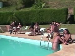 Sluts serve numerous interracial shemales by pool