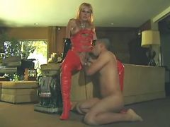 Mistress shemale in red punishes poor latin dude